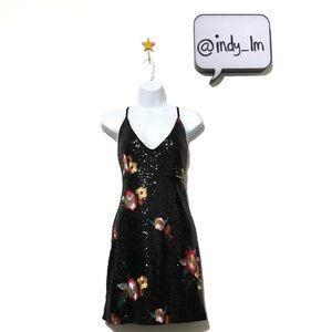 Black sequin mini dress with embroidered flowers